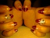 nail art  over red french almond nail