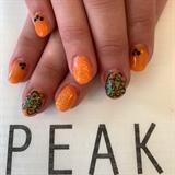 Orange Nails With Black Bling
