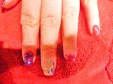 'stones and glitter(her other hand)
