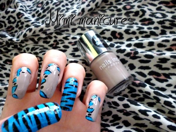 animal print nail art and stripes