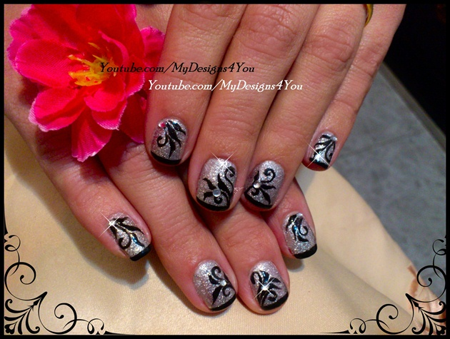 Black and silver floral nails.