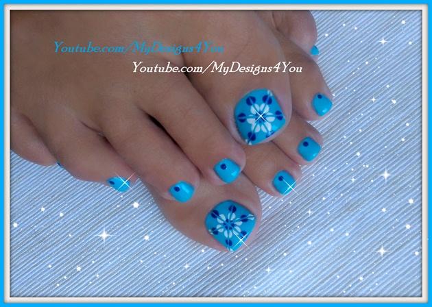 Blue floral toenail art