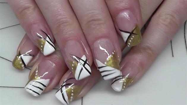 slanted French nail design gold white