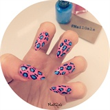 pink and blue animal print nails
