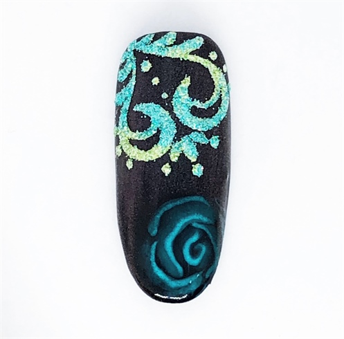 To complete the design, create a scroll pattern in the opposing upper corner using a detail brush and Pop-up Gel. Prior to curing, tap glitters over the top and cure.  Brush off excess glitters.