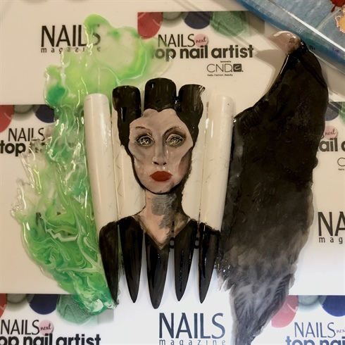 5. I created Maleficent's face with acrylic. Then I painted over the acrylic   oufff … not quite what I had in mind so… I started all over again LOL 😂
