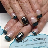 Emerald nails with gold and black design