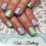 Pastel nails with stamped designs