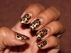 Golden leopard nails