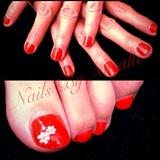 Deep coral polished nails & toes