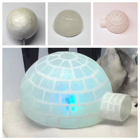 I used a mini foam ball and hard gel to make the igloo. I dipped half of the foam ball into hard gel and cured it for 3 minutes. I wiped off the sticky layer with isopropyl alcohol and filed it into shape. This is followed by painting the igloo with a sheer white gel polish and pearlescent pigment, then I cured for 30 seconds, I then drew a block of ice with white gel polish and finishedit off with a matte top coat.