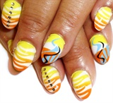 yellow an orange tiger nails