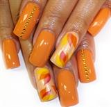 orange polish with petal accents