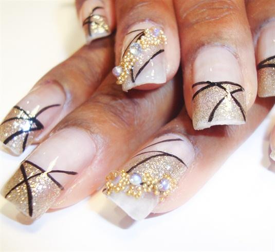 gold glitter with black nail art