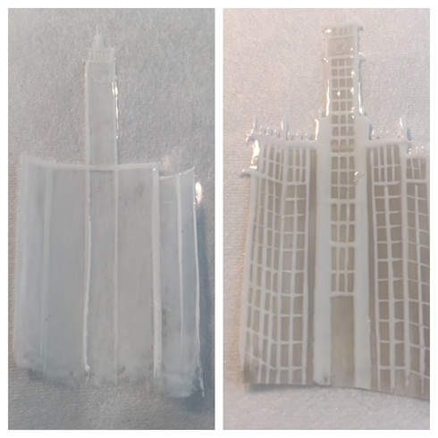 \nAnother technique used to create the skyline was painting the outline of the building over a piece of cellophane.  After curing, I  made a slightly translucent base for the walls of the buildings, so they can glow when lit. I completely covered over my detailing to create strength.\n\n