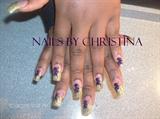 Purple flower w/gold acrylic tips.