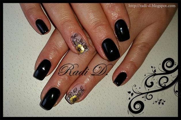 Black gel polish with gold flower