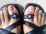 Zebra and orange on my toes, lol