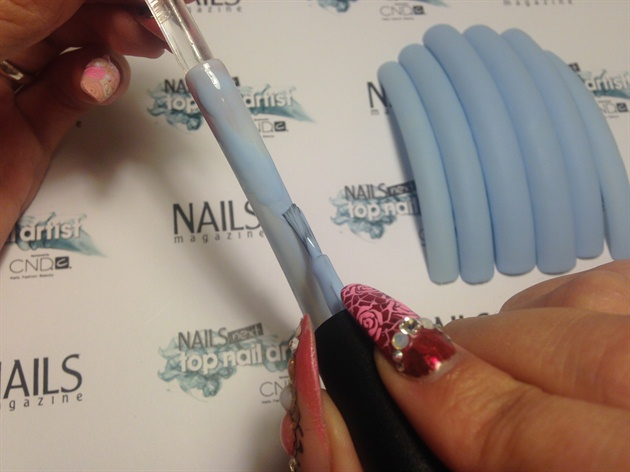 Applying blue gel color and matte top coat.