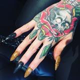 Black And Gold Glitter Stiletto Nails
