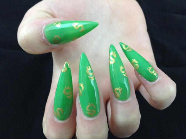 Using a gold acrylic paint, paint Dollar signs on each nail in a random fashion