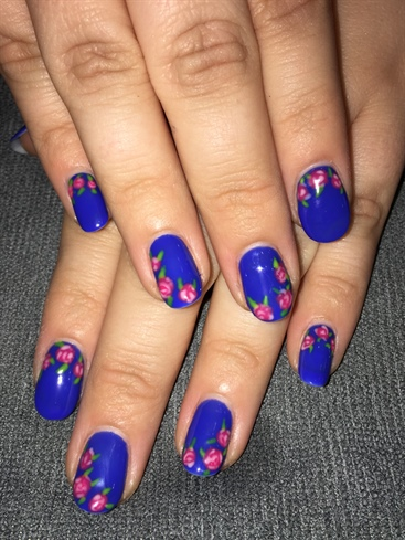 Blue Manicure With Flowers
