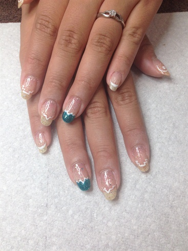 Outline the rest of the nails with the basic shapes on the French tip to mimic the geometric features of the sign.
