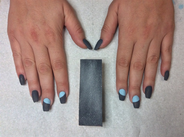 Before hand-painting, prepare your nails surface by buffing them.