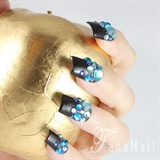 Black color nails with blue rhinestones