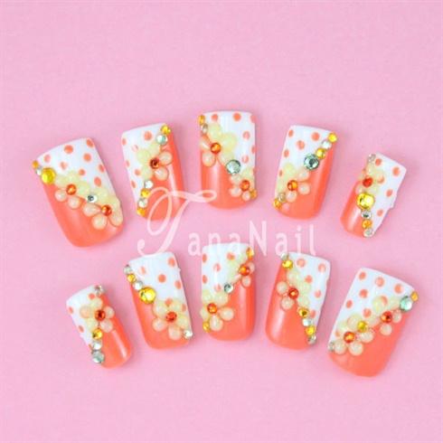 Orange polks dots nails