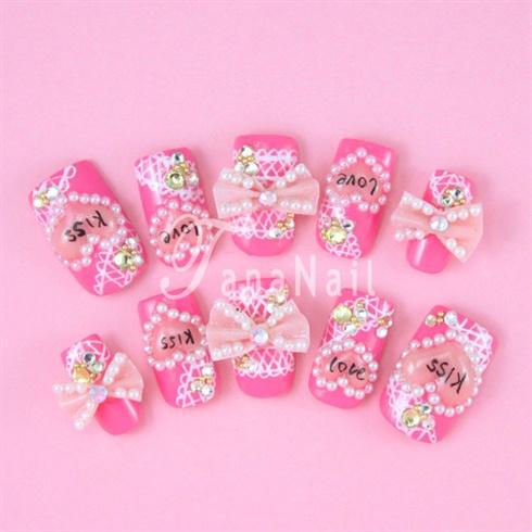 Pink 3D ribbon nails