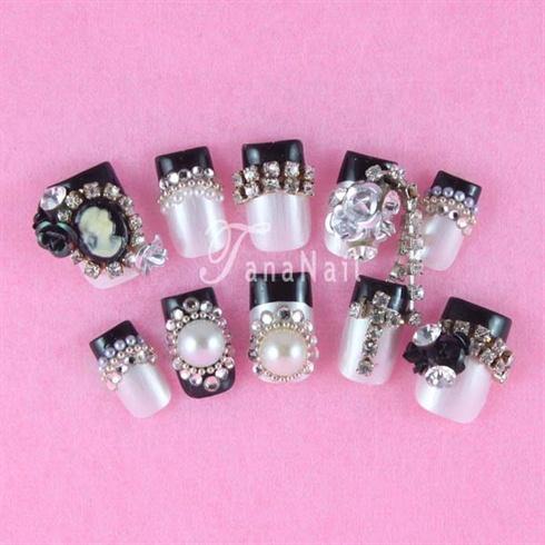 Pearl & black tips nails