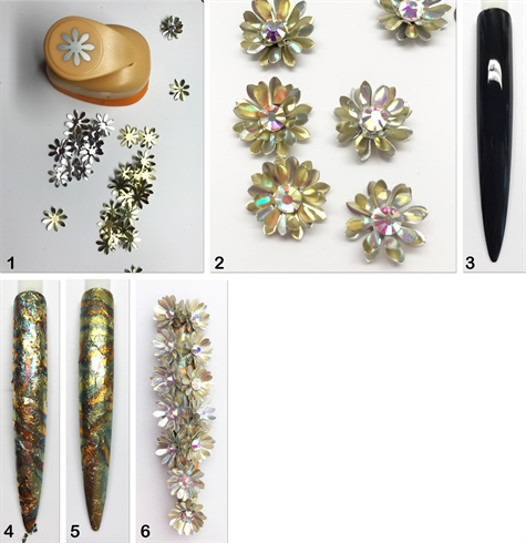 1. Using gold and silver metal sheets, stamp out daisies with a paper punch. 2. Apply three layers of daisies and hold into place with resin. 3. Apply a black LED Gel to the tip. Cure. 4. Attach rustic gold flakes to the tacky surface. 5. Seal with LED Gel. 6. Attach the flowers using LED Clear gel.