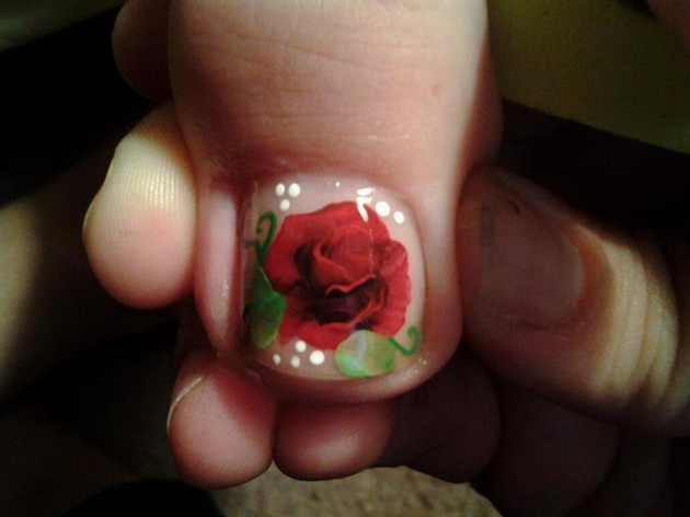 A nail bed of roses