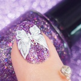 A close-up shot of Butterfly manicure