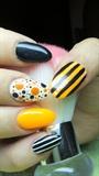 Orange, black and white nails