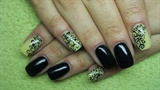 Black and yellow nails with arabesque