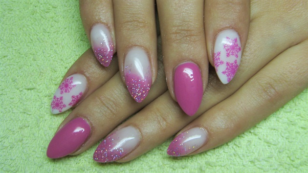 Pink and white nails with snowflakes