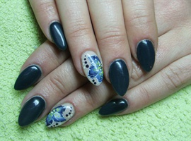 Dark green nails with a flower