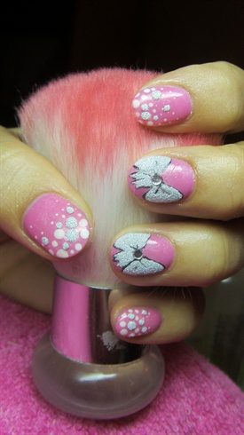 Pink nails with bows and polka dots