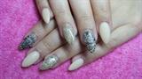Beige stiletto nails with gold glitter