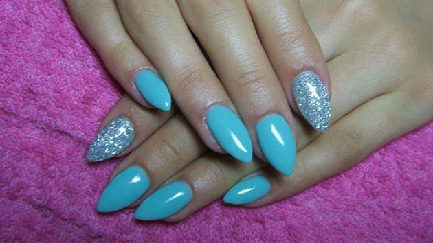Turquoise and silver stiletto nails
