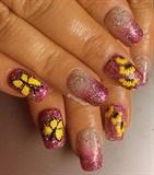 Vibrant yellow on purple nails