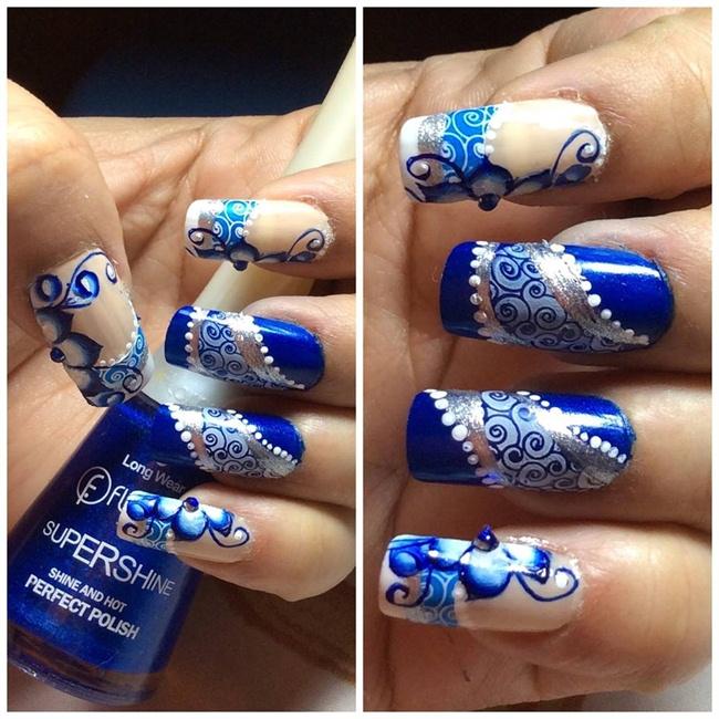 Konad blue floral fantasy nail art - Nail Art Gallery