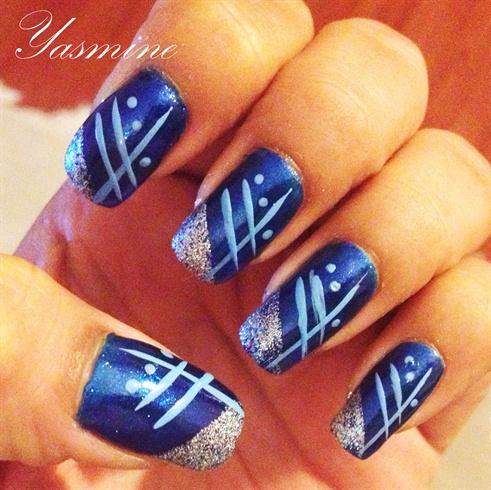 Blue on deep blue handpainted nail art