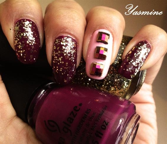 Gold glitter on ruby nail art